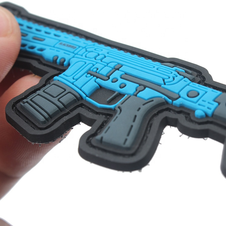 Silicone Rubber Labels Manufacturer Custom 3D Gun Logo Moral Soft PVC Patches Badges with Adhesive Hook and Loop